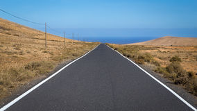 Empty asphalt road. Heading to the sea Stock Photo