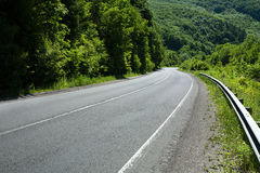 Empty asphalt road highway in forested mountains Stock Photo