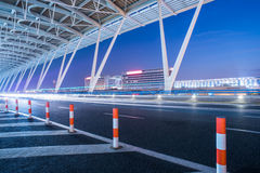 Empty asphalt road through modern city in China. Empty asphalt road through modern city in Shanghai,China Royalty Free Stock Photography