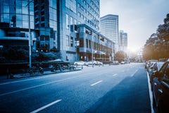 Empty asphalt road through modern city in Shanghai Royalty Free Stock Images
