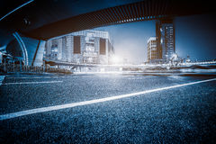 Empty asphalt road through modern city in Shanghai. China Stock Images