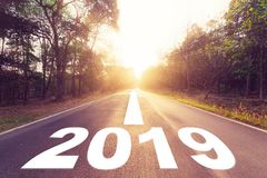 Empty asphalt road and New year 2018 concept. Driving on an empt. Y road to Goals 2018 Stock Image