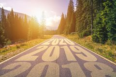 Empty asphalt road and New year 2018, 2019, 2020 concept. Driving on an empty road in the mountains to upcoming royalty free stock photos