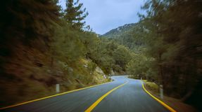 Empty asphalt road and speed motion blur with green trees forest. Marmaris, Turkey. Travel and transportation background.  royalty free stock images
