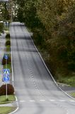 Empty asphalt road with a steep climb Royalty Free Stock Images