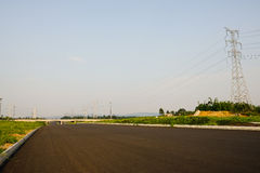 Empty asphalt road in sunny summer afternoon Stock Photos