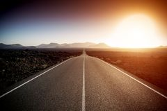 Road on a sunny summer day. Empty asphalt road on a sunny summer day royalty free stock photography