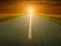 Empty asphalt road at sunset in motion blur Royalty Free Stock Photo