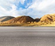 Empty asphalt road in tibetan area Royalty Free Stock Photos