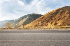 Empty asphalt road in tibetan area Stock Images