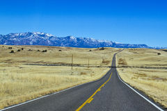 Empty asphalt road toward the mountains Royalty Free Stock Image