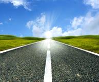 Empty asphalt road. Towards bright sun Royalty Free Stock Photos