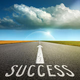 Empty asphalt road towards cloud and signs symbolizing success Royalty Free Stock Photo