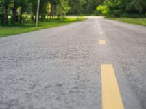 Empty asphalt road with trees beside the road. road to success c royalty free stock photography