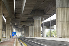 Empty asphalt road under the new expressway line. Royalty Free Stock Photography