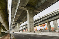 Empty asphalt road under the new expressway line. Stock Image