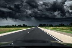 Empty asphalt road. Way to thunder storm stock image