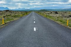 Empty asphalt road into wild nature of Iceland in summer Stock Photography