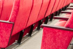 Empty assembly hall with red chairs in rows. concept of trainings, business meetings and conferences. For decor and design background texture royalty free stock images