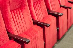 Empty assembly hall with red chairs in rows. concept of trainings, business meetings and conferences. For decor and design background texture stock photos