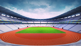 Empty athletics stadium with track and grass field at front day view Royalty Free Stock Photos