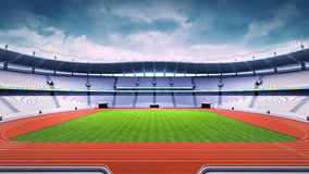 Empty athletics stadium with track and grass field at side day view Royalty Free Stock Photo