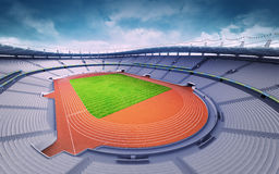 Empty athletics stadium with track and grass field at upper day view Stock Photography