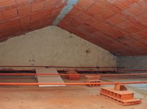 Attic of the house with sloping roof Stock Images