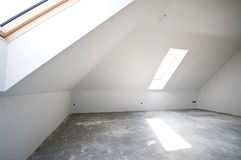 Empty attic or loft room. With roof windows ready for development royalty free stock photo