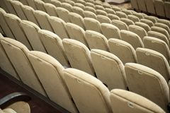 Empty auditorium with beige chairs, theatre or conference hall royalty free stock images