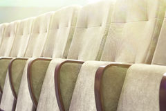 Empty auditorium with beige chairs, theatre or conference hall Stock Image