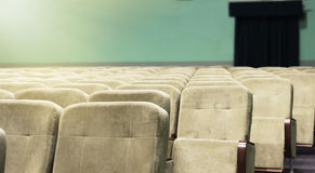 Empty auditorium with beige chairs, theatre or conference hall Royalty Free Stock Image