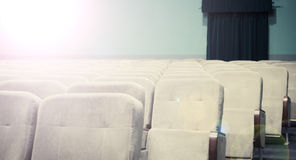 Empty auditorium with beige chairs, theatre or conference hall Stock Photo