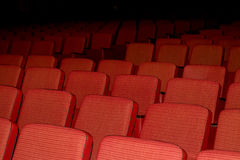 In the empty auditorium with red chairs royalty free stock photo