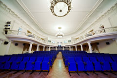 Empty auditorium with rows of chairs. Empty auditorium with rows of blue chairs Stock Image
