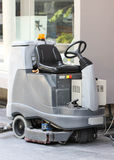 Empty Automatic Scrubber Machine Parked. Beside Big Pole Royalty Free Stock Photo