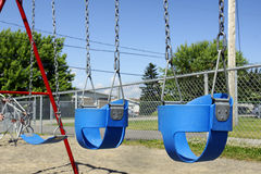 Empty baby swings Royalty Free Stock Image