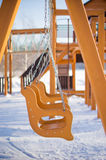 Empty baby swings on playground Stock Image