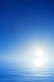Empty background sky and water. Empty blue sky and water background with white sun Royalty Free Stock Images