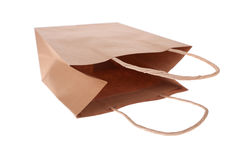 Empty bag. An empty brown paper shopping bag on its side isolated on white Royalty Free Stock Photos