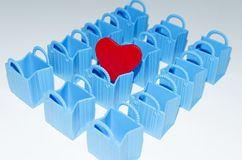 Empty bags and a red heart Royalty Free Stock Photos