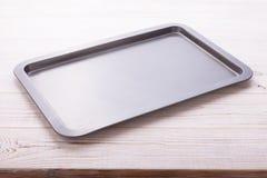 Empty baking tray on white wooden desk Royalty Free Stock Image