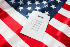 Empty ballot or vote on american flag. Voting, election and civil rights concept - empty ballot or vote on american flag Royalty Free Stock Photos