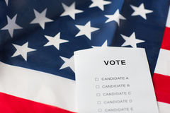 Empty ballot or vote on american flag. Voting, election and civil rights concept - empty ballot or vote on american flag Royalty Free Stock Image
