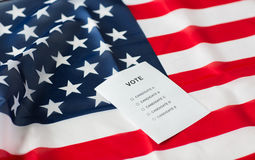 Empty ballot or vote on american flag. Voting, election and civil rights concept - empty ballot or vote on american flag Stock Photos