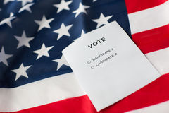 Empty ballot or vote on american flag. Voting, election and civil rights concept - empty ballot or vote with two candidates on american flag Royalty Free Stock Image