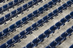 Empty Ballpark. Rows of empty ballpark chairs at Nationals Park in Washington, DC. This photo was taken very early before a game, so there were barely any people royalty free stock images