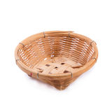 Empty bamboo basket on a white background Royalty Free Stock Images
