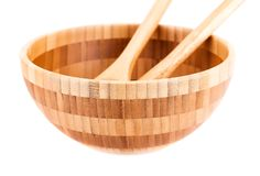 Bamboo bowl. Empty bamboo bowls and wooden spoons  isolated on white background Stock Images