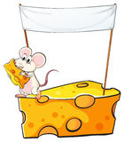 An empty banner above the cheese with a mouse Royalty Free Stock Images